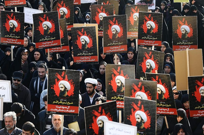 Protesters with posters of Shi'ite cleric Nimr al-Nimr rallied against Saudi Arabia in Teheran yesterday, after Riyadh executed the cleric along with others it accused of being Al-Qaeda members.