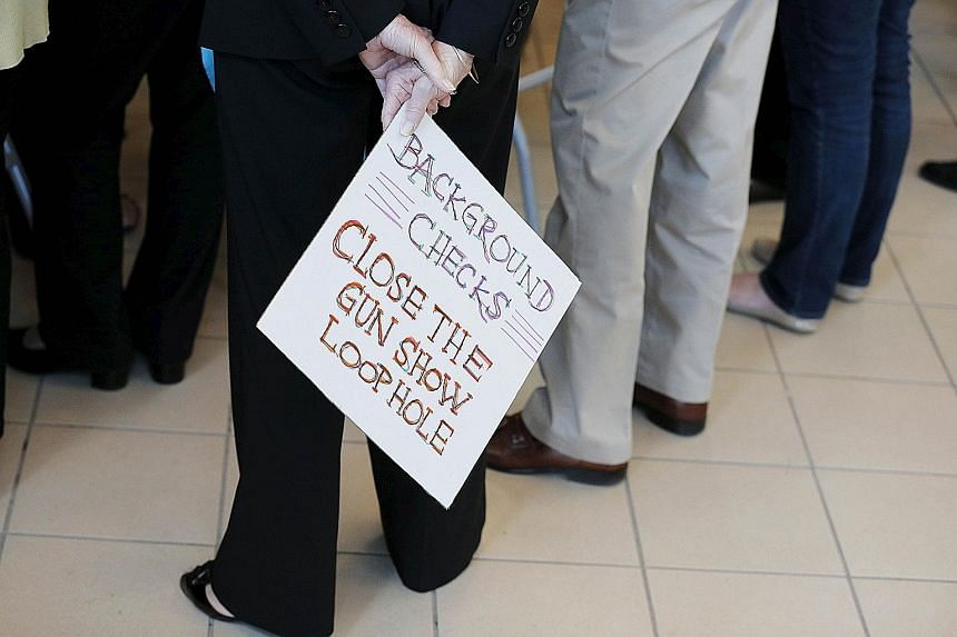 A sign calling for further gun control at a campaign stop last October by US Democratic presidential candidate Hillary Clinton in Nashua, New Hampshire. President Obama is expected to move ahead as soon as this week with a series of executive actions