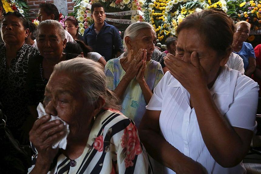 People (above) grieving on Sunday at the funeral of the newly installed mayor, Ms Mota in Temixco. Morelos state has been plagued by drug cartel violence, kidnappings and extortion, and Ms Mota had vowed to clean up crime when she took office.