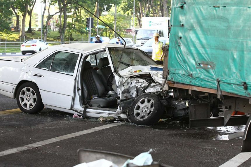 The white Mercedes had crashed into the lorry, which was turning right to enter the PIE.
