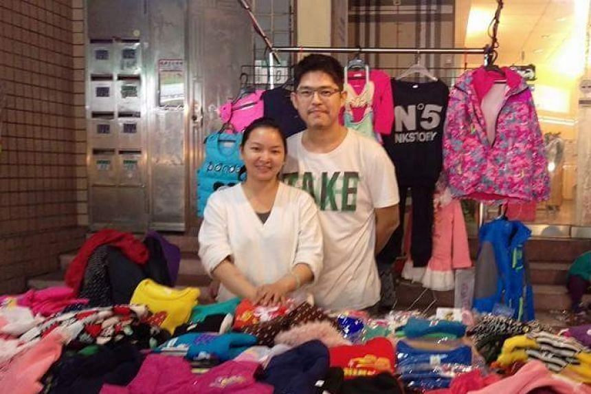 The Huangs, a Taiwanese couple whose youngest daughter had eye cancer, sell clothes online and at night markets to make ends meet.