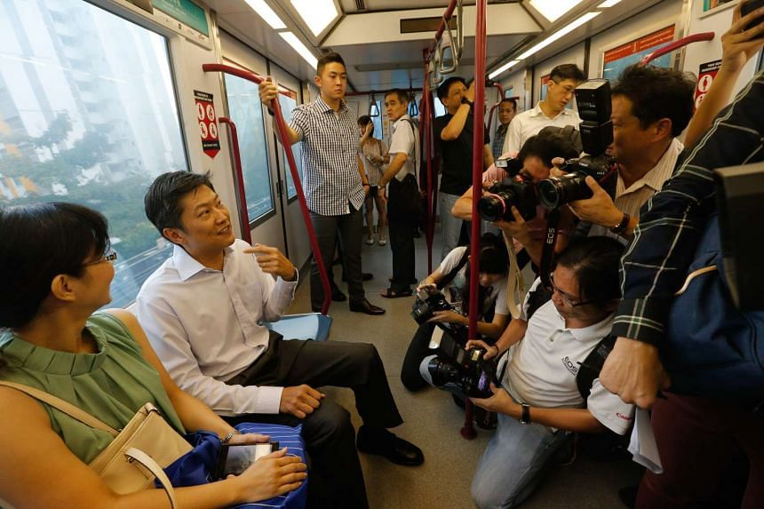 Senior Minister of State for Transport Ng Chee Meng (seated, second from left) taking a ride on the new train.