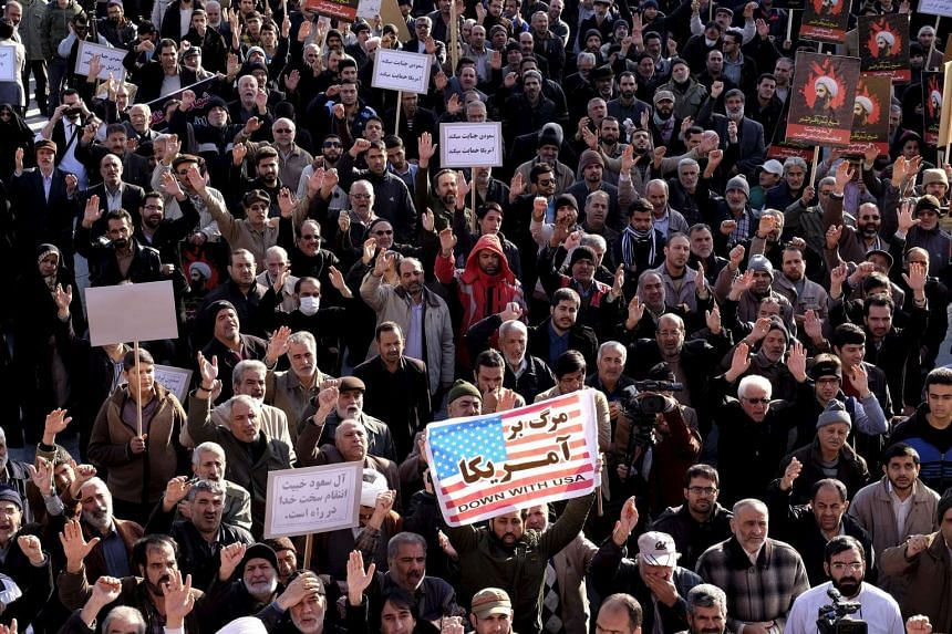 Protesters chanting slogans during a demonstration against the execution of Sheikh Nimr al-Nimr in Saudi Arabia, at Imam Hussein square in Teheran on Jan 4, 2016.
