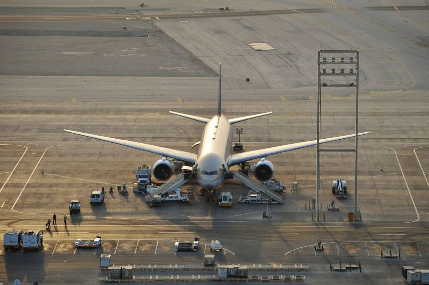 A Saudi Arabian airlines plane on the tarmac at the King Fahd International Airport in Dammam.