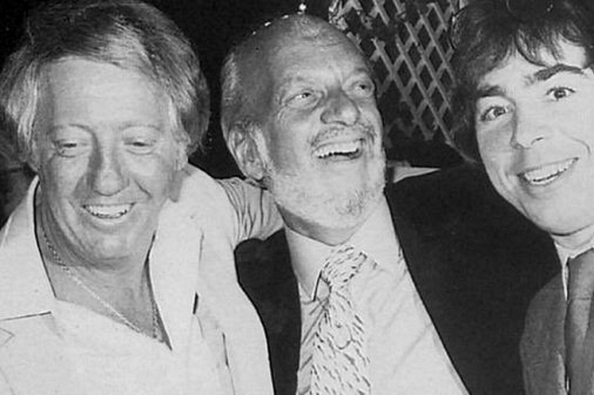 Robert Stigwood (left) with Andrew Lloyd Webber (right) and Hal Prince at the opening night of the musical Evita in 1980.