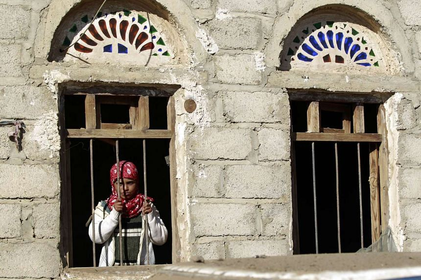 A Yemeni youth standing at the window of a house in Sanaa on Dec 29, 2015.