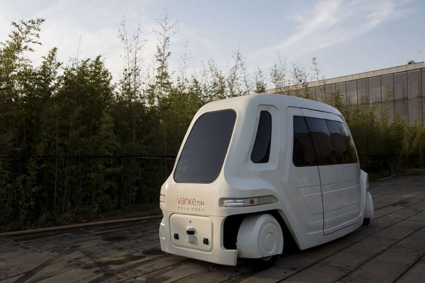 A driverless vehicle runs at Vanke's Building Research Centre testing area in Dongguan, south China's Guangdong province on Nov 2, 2015.