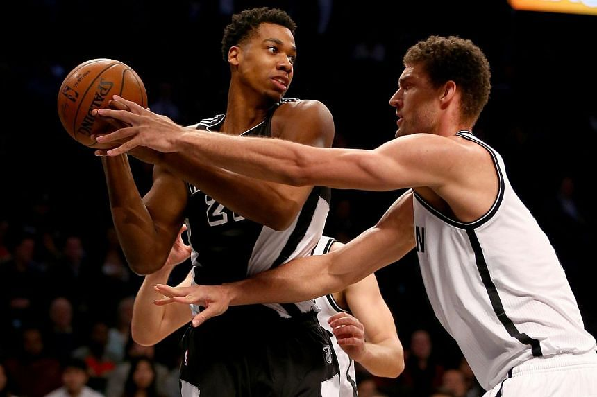 Hassan Whiteside (left) of the Miami Heat tries to get around Brook Lopez of the Brooklyn Nets.