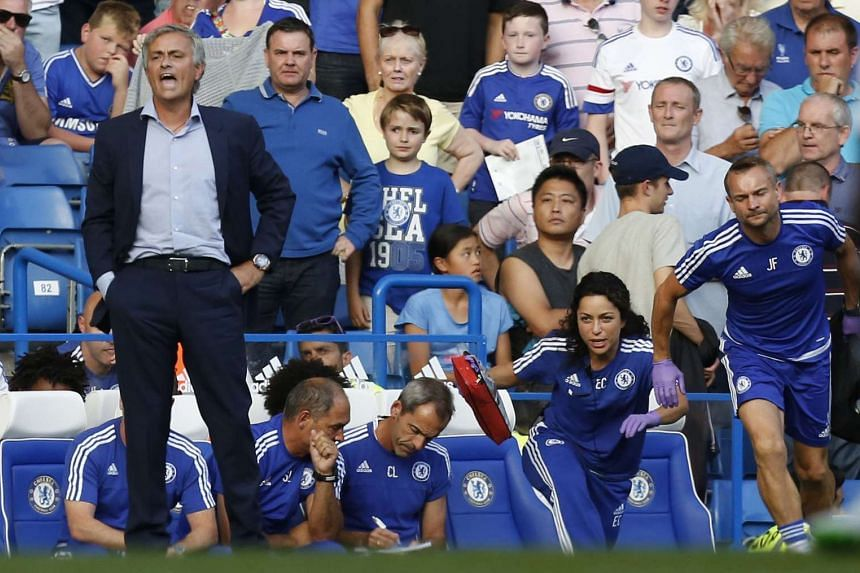 Chelsea doctor Eva Carneiro (second right) and head physio Jon Fearn (right) leaving to treat player Eden Hazard while manager Jose Mourinho (left) looks on during the game against Swansea City on Aug 8, 2015.