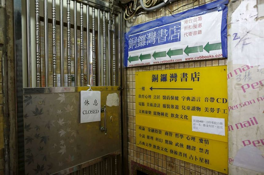 A closed sign is seen outside the Causeway Bay Book in Hong Kong, China on Jan 1, 2016.