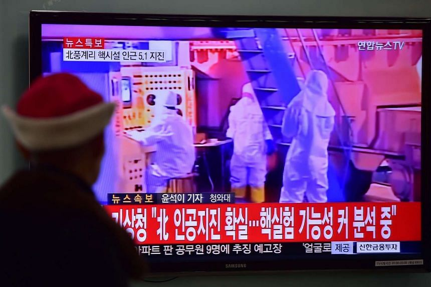 A man watching a news report in Seoul after a 5.1-magnitude tremor was detected next to North Korea's main atomic test site on Jan 6.