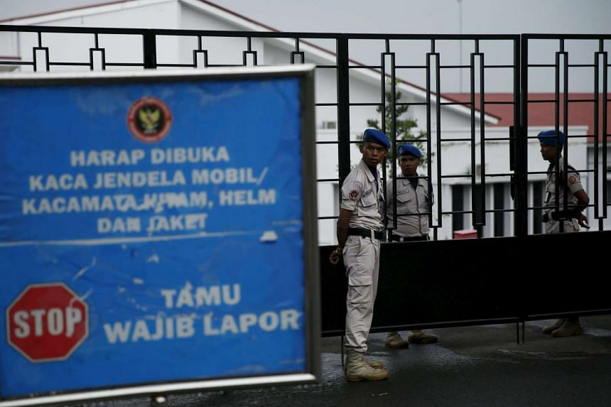 Security guards stand at the gate of the National Counter-Terrorism Agency building in Bogor, Indonesia.