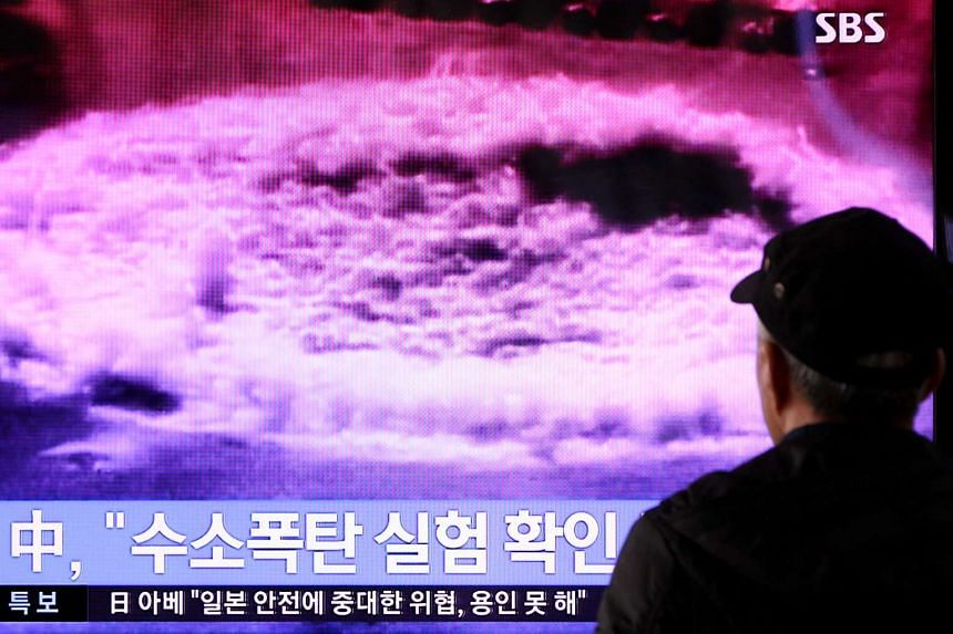 A man watches a television screen showing a news broadcast on North Korea's nuclear test in Seoul.