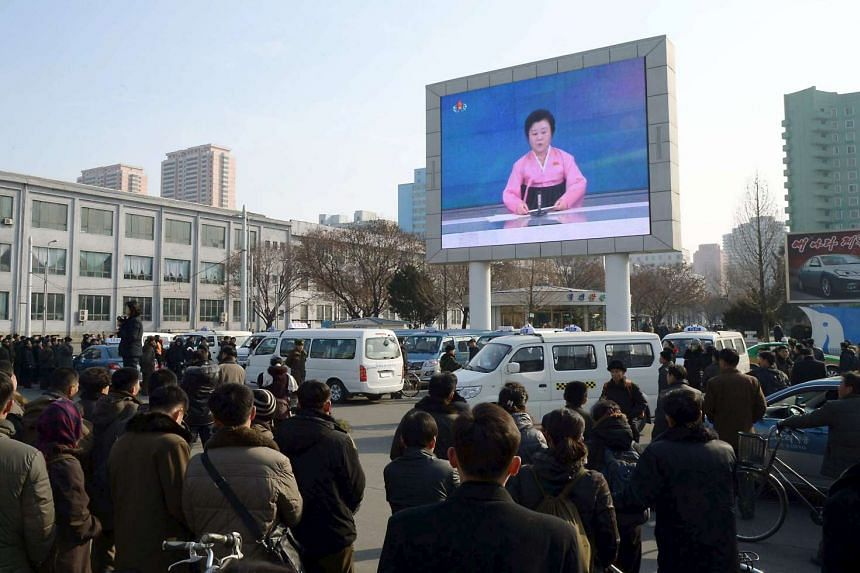 A huge screen broadcasting the government's announcement on the nuclear test in Pyongyang, North Korea.