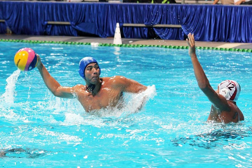 Singapore captain Eugene Teo (left) in action against Kuwait at the Toa Payoh Swimming Complex in 2013.
