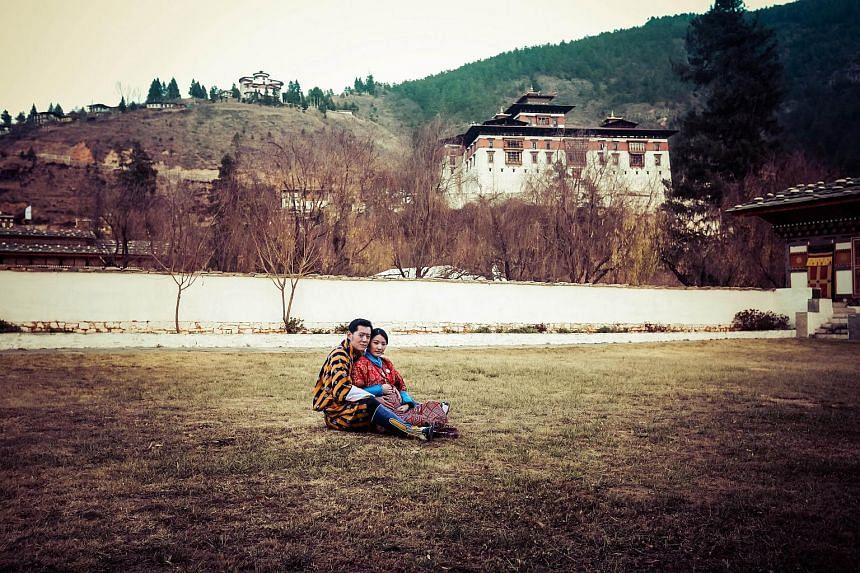 King Jigme Namgyel Wangchuck and Queen Jetsun Pema posing at Paro Ugyen Pelri Palace in Bhutan.
