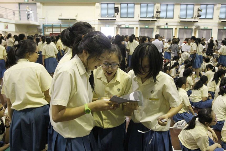 Crescent Girls' School students comparing their O-level results in 2013.