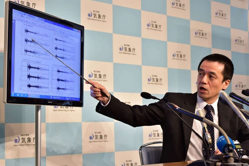 Japan's meteorological agency officer Yohei Hasegawa displays a chart showing seismic activity after North Korea's nuclear test.