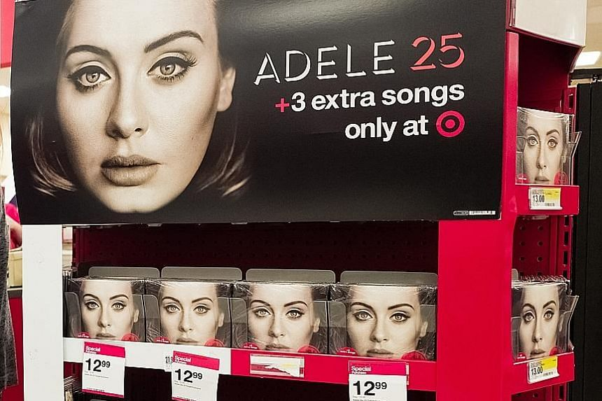 A display of Adele CDs at a Target store in Jersey City in the United States. The singer did not make her album, 25, available on streaming sites.