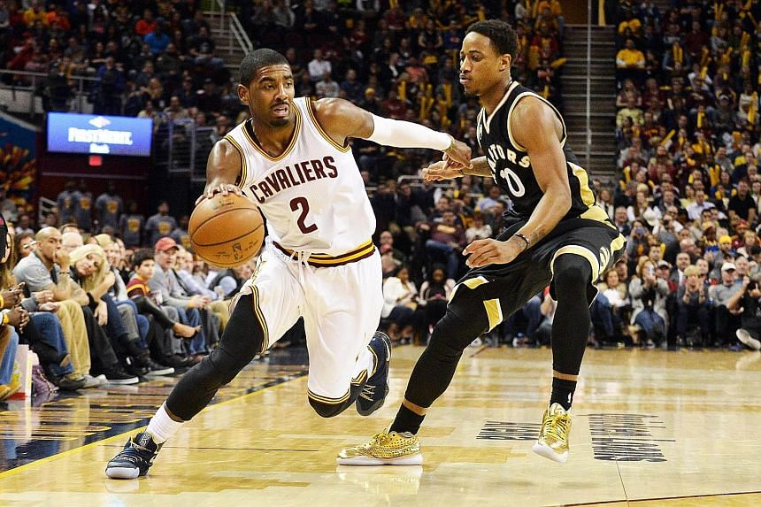 The Cleveland Cavaliers' Kyrie Irving dribbling past Toronto Raptors guard DeMar DeRozan during the fourth quarter at Quicken Loans Arena. The Cavaliers defeated the Raptors 122-100 for their fourth straight victory.