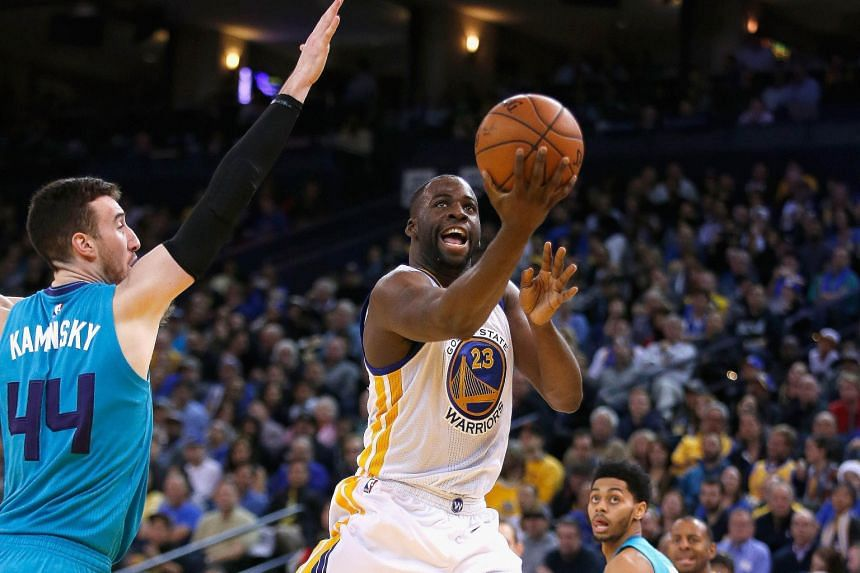 Draymond Green of the Golden State Warriors going up for a shot against Frank Kaminsky of the Charlotte Hornets at the Oracle Arena. The Warriors won the game 111-101, improving their season record to 32-2.