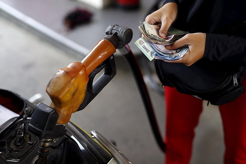 The rupiah may decline by 6.2 per cent against the greenback over the next 12 months, according to a Bloomberg survey.