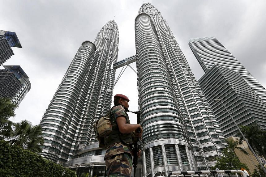 The Petronas Towers in Kuala Lumpur. The government may focus on politics and 1MDB, rather than on the economy.