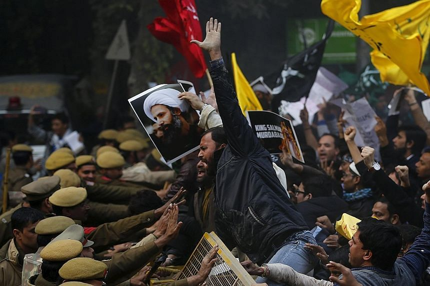 Shi'ite Muslims protesting against the execution of cleric Nimr al-Nimr in front of the Saudi Embassy in New Delhi on Monday.