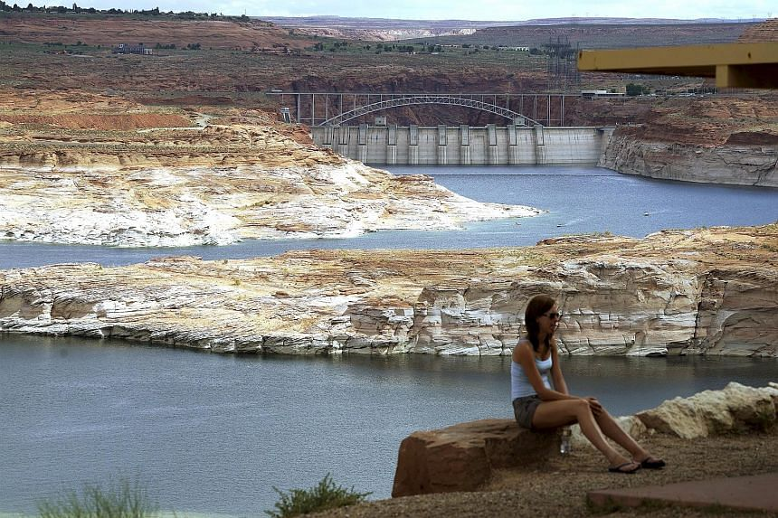 The Glen Canyon Dam (background) across the Colorado River near Page, Arizona. Water consumption for power generation is expected to double in 40 years, according to a study published in the journal Nature Climate Change.