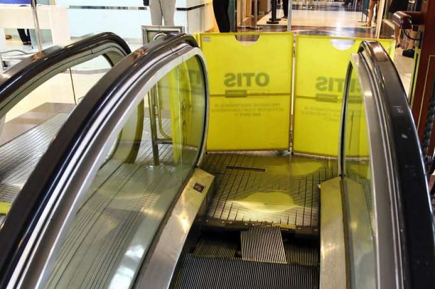 A woman narrowly escaped injury after an escalator in The Arcade at Raffles Place broke on Tuesday, Jan 5, 2016.