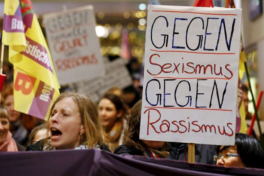 "Protesters in Cologne, Germany with a placard that reads ""Against Sexism - Against Racism"" on Jan 5, 2016."