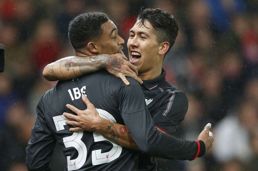Jordon Ibe celebrates with Roberto Firmino after scoring the first goal for Liverpool.
