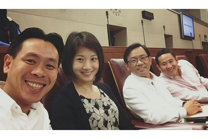(From left) MPs Louis Ng, Sun Xueling, Chong Kee Hiong and Amrin Amin posing for a selfie in their parliament seats.
