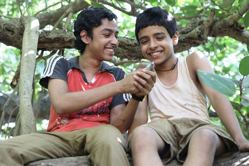 """Actors Riddhi Sen (left) and Soham Maitra in a scene from the film Chauranga. They play brothers who are members of the Dalit caste, also known as """"untouchables""""."""