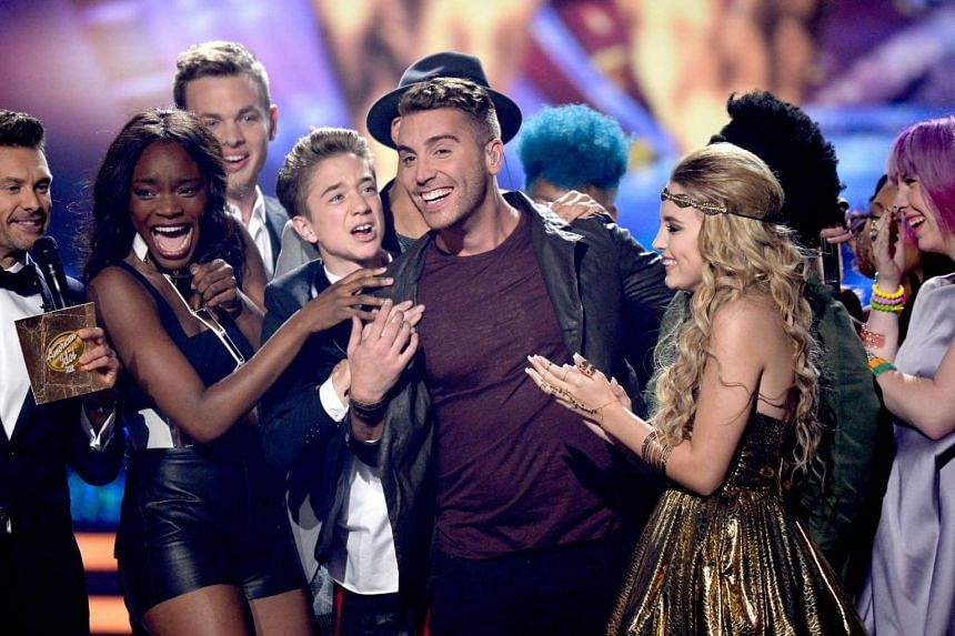 Host Ryan Seacrest (far left) announcing the winner Nick Fradiani (centre) onstage during American Idol 14 grand finale last year.
