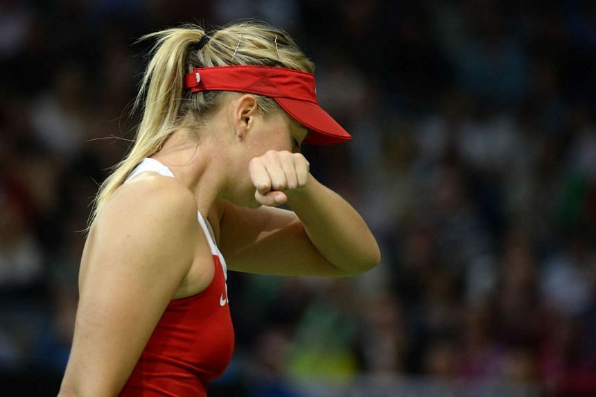 Maria Sharapova (above) hurt her left forearm in practice recently while Simona Halep has a sore Achilles' tendon.