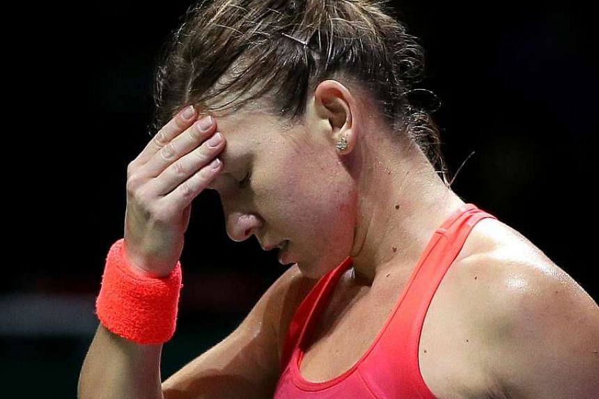 Maria Sharapova hurt her left forearm in practice recently while Simona Halep (above) has a sore Achilles' tendon.