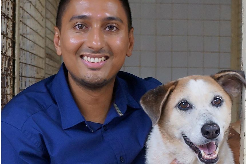 Dr Jaipal Singh Gill with 10-year-old Ida, who has been with the SPCA since March 2008 and is awaiting a home.
