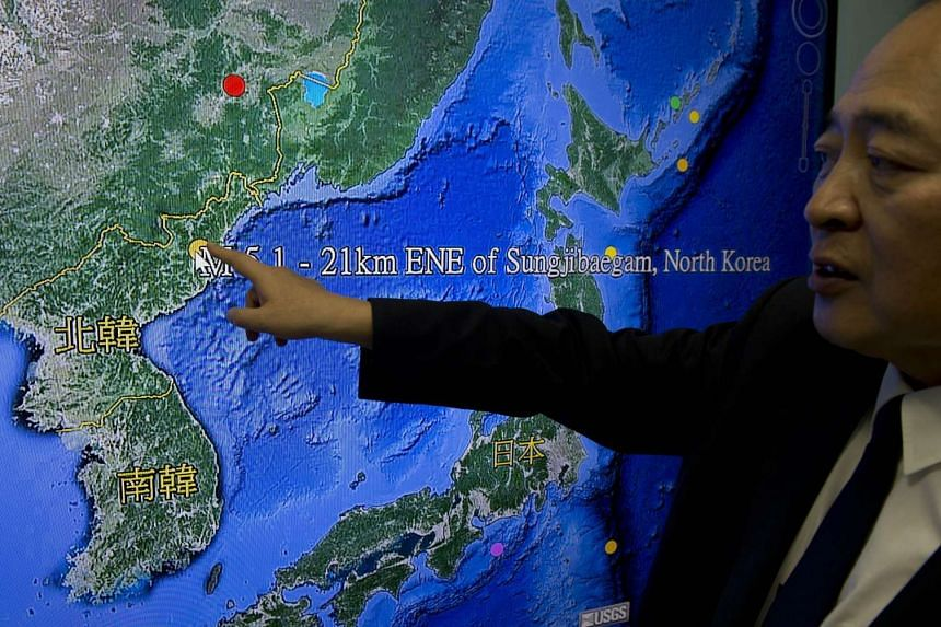 The director of Taiwan's Seismology Center points to the locations  showing North Korea's first hydrogen bomb test site.