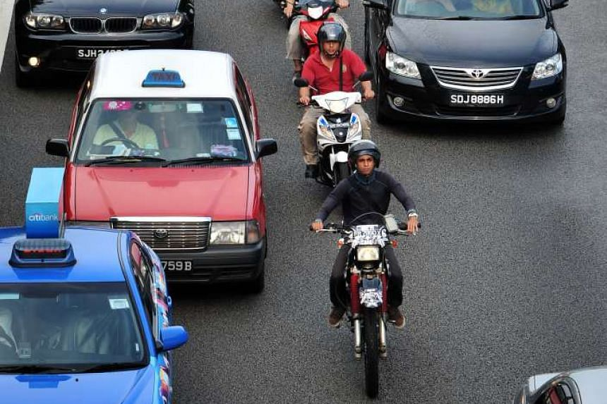 Motorcyclists on the Pan-Island Expressway during evening rush hour in March 2011.