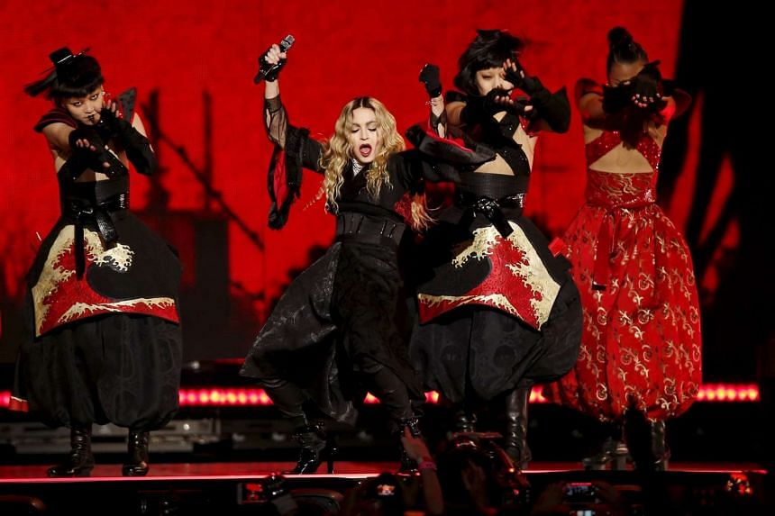 Madonna performing at the AccorHotels Arena in Paris on Dec 9.