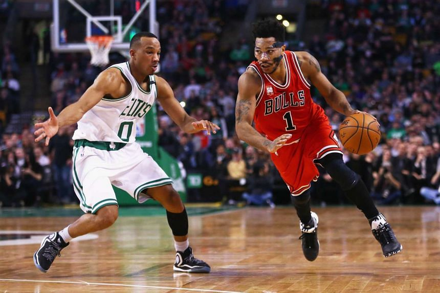 Derrick Rose #1 of the Chicago Bulls drives against Avery Bradley #0 of the Boston Celtics during the second half at TD Garden.