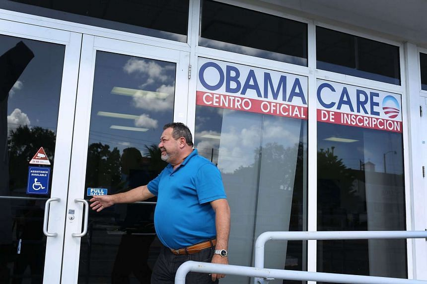 A man entering an insurance company's office, where people can sign up for plans under Obamacare, on Dec 15 in Miami, Florida.