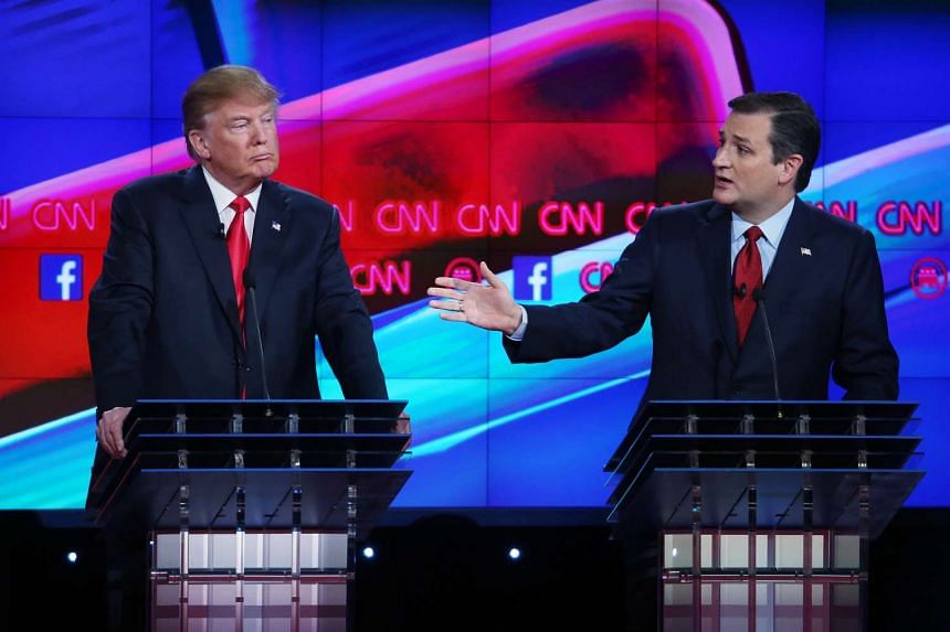 Republican presidential candidate Ted Cruz (right) speaking as rival Donald Trump listens during the CNN Republican presidential debate on Dec 15, 2015 in Las Vegas, Nevada.
