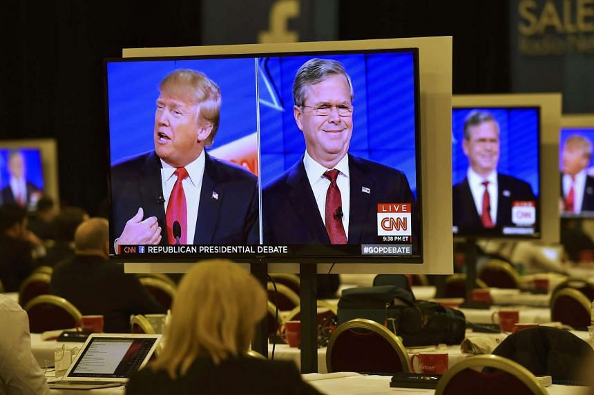 Republican US presidential candidates Donald Trump (left) and Jeb Bush are seen debating on video monitors in Las Vegas on Dec 15, 2015.