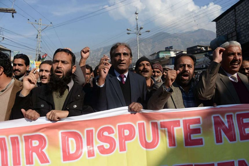 Activists march during a protest demanding the implementation of the United Nations resolution on Kashmir.