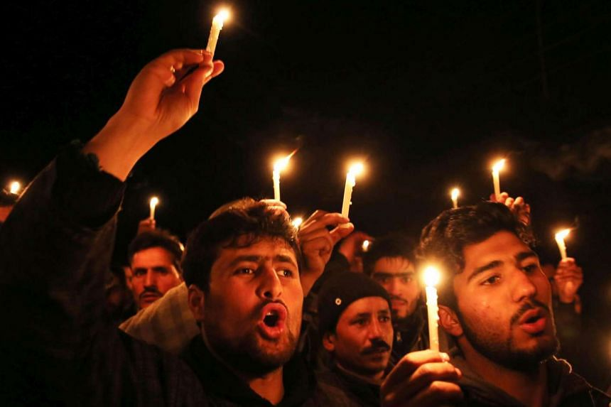 Kashmiri Shiite Muslims hold candles during a candle light protest on the outskirts of Srinagar, the summer capital of Indian Kashmir.