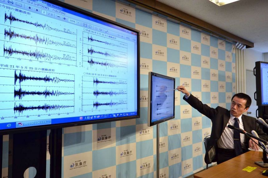 Japan meteorological agency officer Yohei Hasegawa displaying a chart showing seismic activity after North Korea's nuclear test, in Tokyo on Jan 6, 2016.