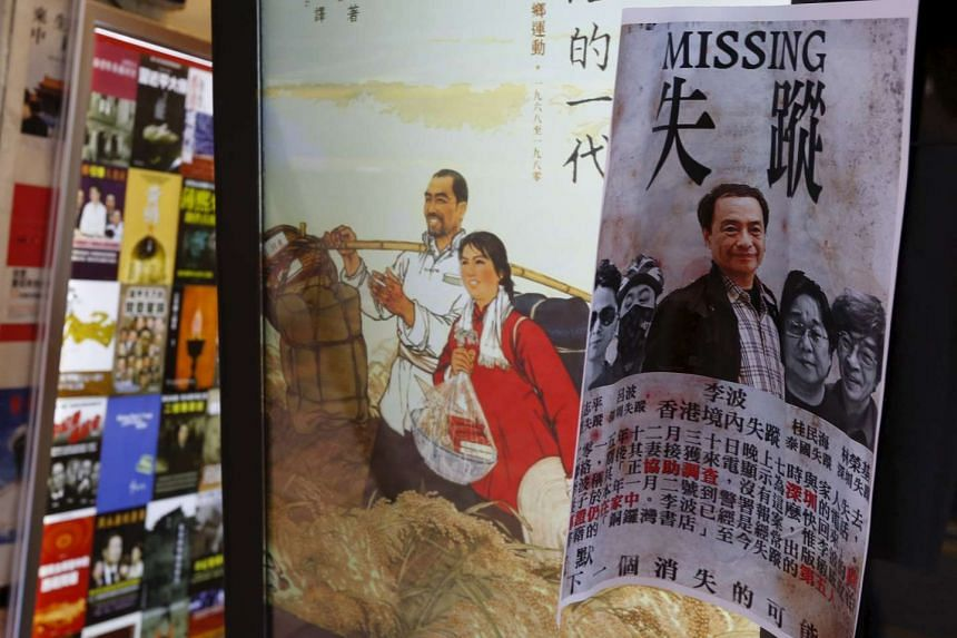 A printout showing publisher Lee Bo is displayed outside a bookstore at Causeway Bay shopping district in Hong Kong.