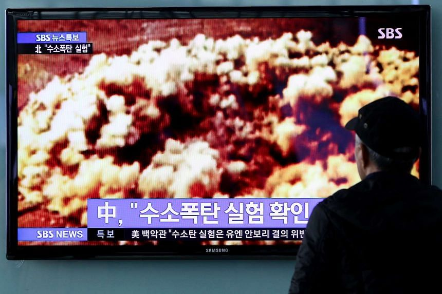A man watches a television screen showing a news broadcast on North Korea's nuclear test at Seoul Station in Seoul, South Korea.